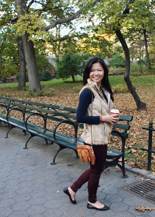 Jenny in Jacquard; NYC fashion blogger; style blog; outfit photos; Joe Fresh navy long sleeve t-shirt; Zara Girl tan fur vest; Zara oxblood maroon burgundy skinny jeans; Rebecca Minkoff cognac brown BF crossbody bag; Starbucks holiday cup; Zara black leather flat