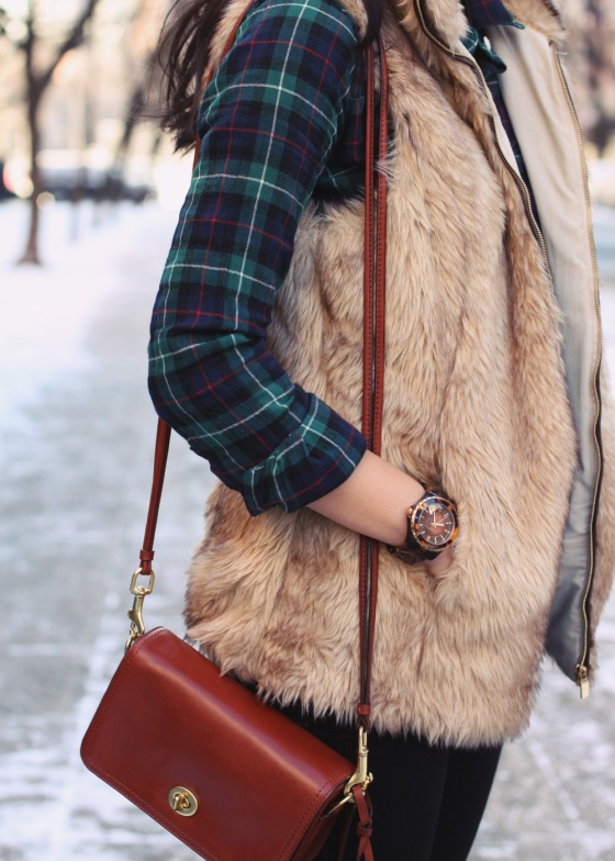 Jenny in Jacquard; NYC fashion blog; style blogger; winter snow outfit photos; J.Crew green plaid shirt; Zara Kids faux fur vest; Coach LEgacy Penn crossbody bag in cognac; Michael Kors tortoise gold boyfriend watch; C. Wonder black calf hair skinny bangle; Zara zip skinny jeggings; Sperry Top-Sider x J.Crew snow boots